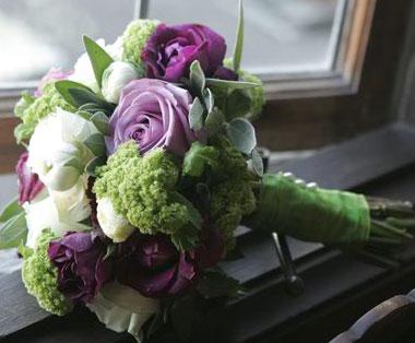 Romantic and beautiful wedding bouquet made of dark purple callas