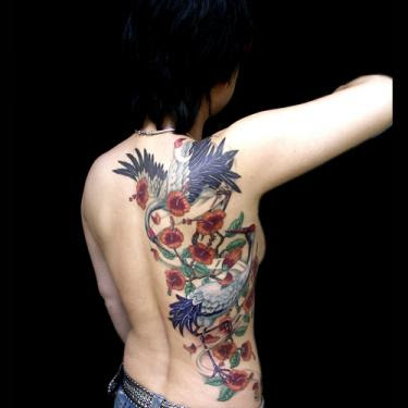 Beautifull Flower Tattoo Design on Back Body Girl