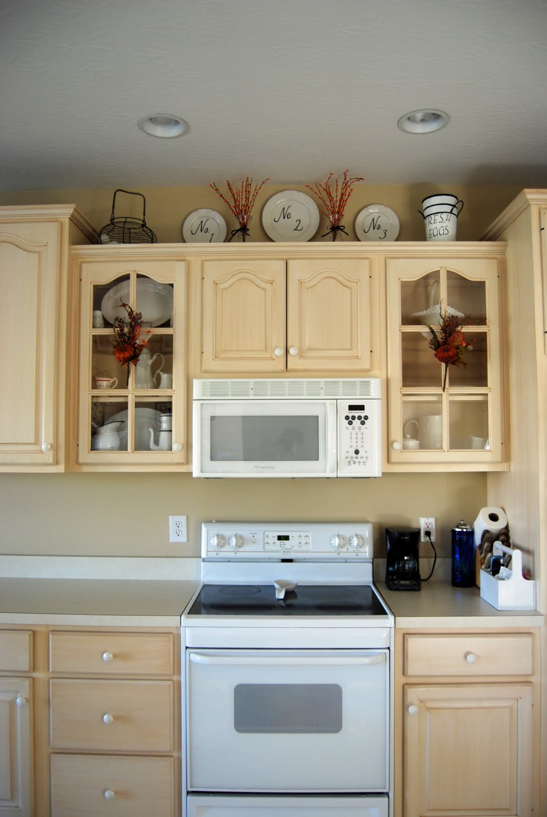 Decor for on top of kitchen cabinets best home How to decorate top of cabinets