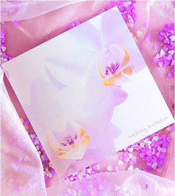 orchid wedding invitations Look for a professional graphic designer who is