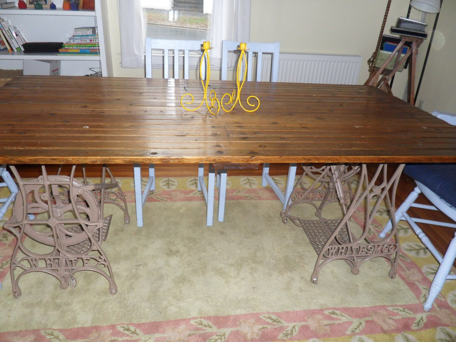 reclaimed crafts: barn door + sewing machine bases = dining room table