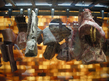 Meat Hanging in front of Himalayan Salt