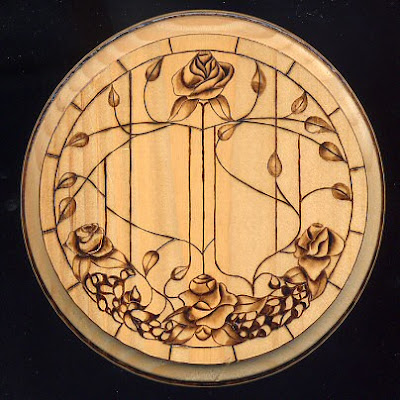 Wood burned interpretation of stained glass roses.