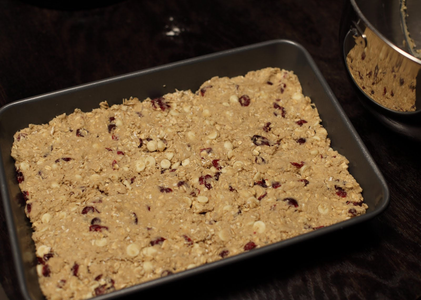 Then add the white chocolate chips and dried cranberries. Mix until ...
