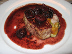 Goat Cheese Stuffed Pork Tenderloin with Red Wine Balsamic Cherry Sauce