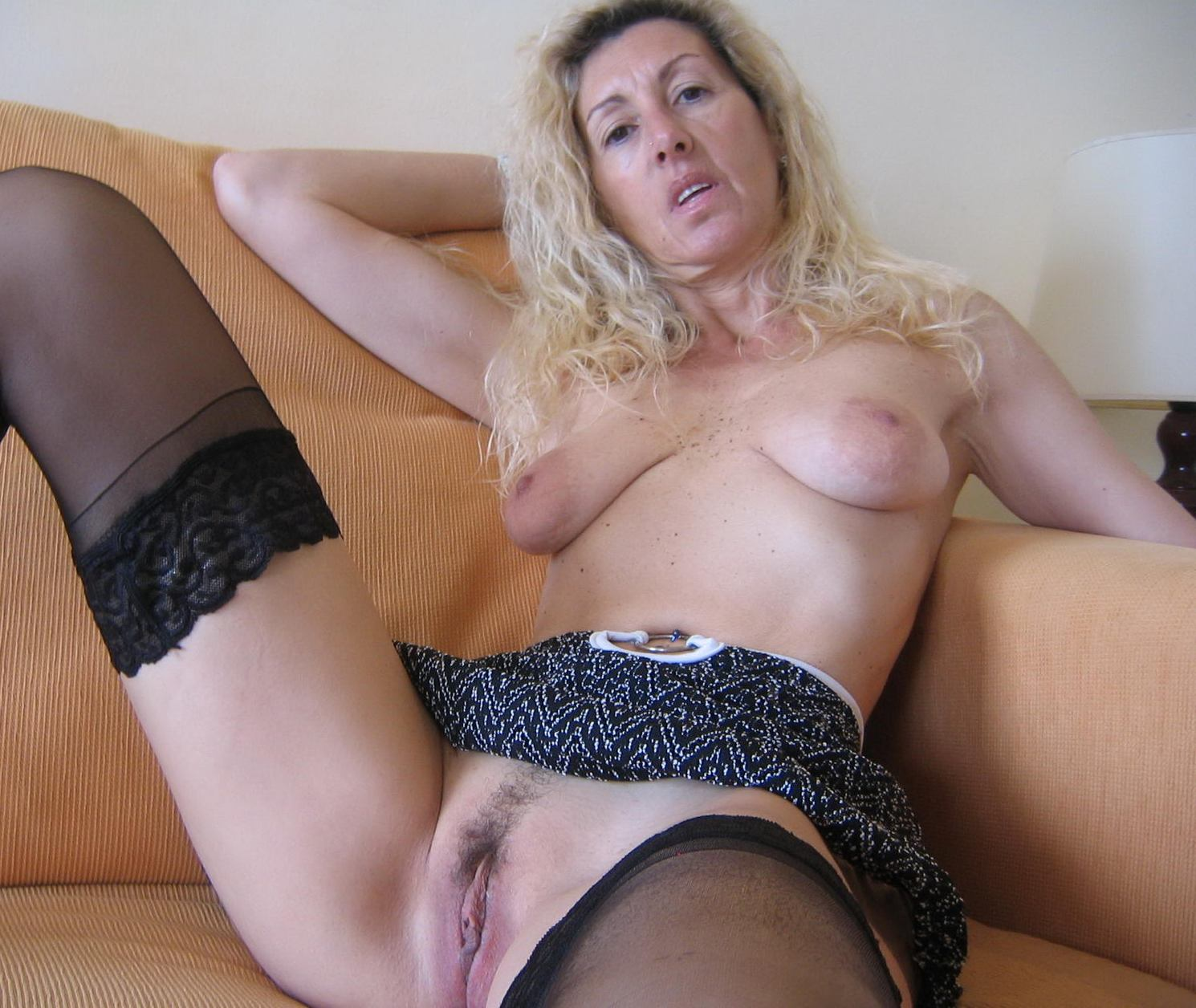 image Milf over 60 in collant with a little cum on skirt