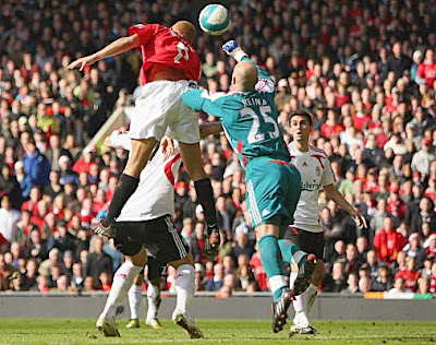 Wes Brown of Manchester United rises to score against Liverpool.