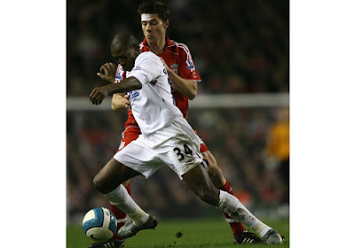 Xabi Alonso of Liverpool battles with Luis Boa-Morte of West Ham United