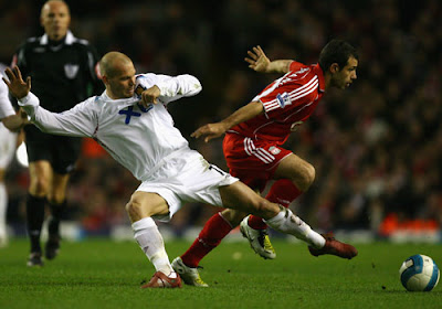 West Ham United midfielder Freddie Ljungberg challenges Javier Mascherano of Liverpool