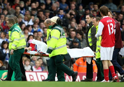 Eduardo da Silva of Arsenal is stretchered off after breaking his leg
