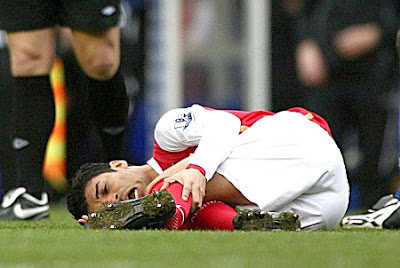 Arsenal's Eduardo lies on the ground in pain with a broken leg