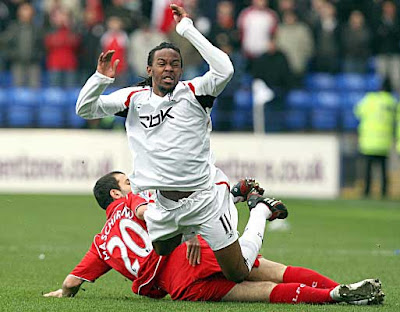 Bolton Wanderers defender Ricardo Gardner is fouled by Liverpool midfielder Javier Mascherano during their Premier league match at The Reebok Stadium, in Bolton on March 2, 2008.