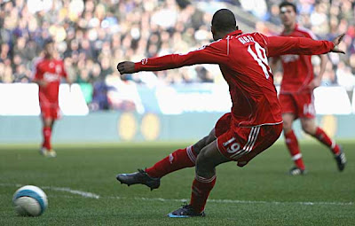 Ryan Babel of Liverpool scores his team's second goal against Bolton.