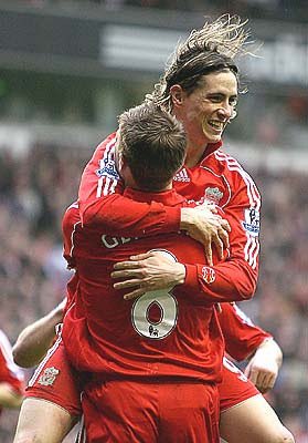 Liverpool's Fernando Torres, top, celebrates scoring against Reading with teammate Steven Gerrard
