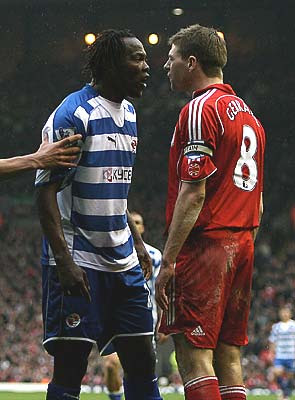 Steven Gerrard of Liverpool is confronted by Andre Bikey of Reading.