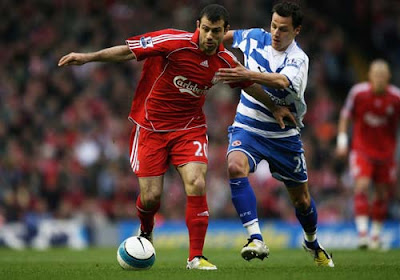 Javier Mascherano of Liverpool in action with Marek Matejovsky of Reading