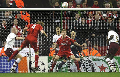 Sami Hyypia of Liverpool scores an equalizing goal with a corner kick header in the 30th minute.