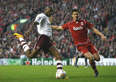 Xabi Alonso of Liverpool is unable to stop Abou Diaby of Arsenal scoring the opening goal.