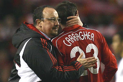 Liverpool Manager Rafael Benitez congratulates Jamie Carragher at the end of the their Champions League quarterfinal victory over Arsenal.