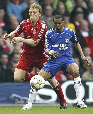 Liverpool's Dirk Kuyt challenges for the ball with Chelsea's Ashley Cole.