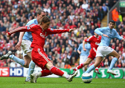 Fernando Torres of Liverpool scores the opening goal
