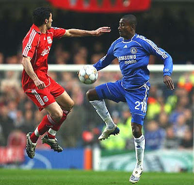 Alvaro Arbeloa of Liverpool takes jumps with Salomon Kalou of Chelsea during the first half of action.