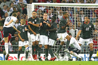 England's Steven Gerrard (L) takes a free kick against the USA.