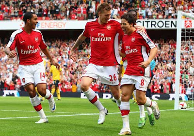 Samir Nasri of Arsenal celebrates after he scored his first goal together with his team mates Nicklas Bendtner and Theo Walcott 
