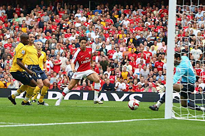 Samir Nasri of Arsenal scores the opening goal of the Premier League season on his debut game.