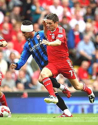 Robbie Keane of Liverpool tackles Jeremie Aliadiere of Middlesbrough after the Boro forward suffered a head injury but continued playing.