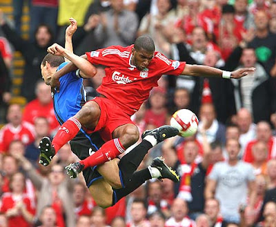 Ryan Babel of Liverpool goes up for a challenge against Emanuel Pogatetz of Middlesbrough during their Barclays Premier League at Anfield in Liverpool, England.