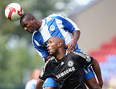 Emmerson Boyce of Wigan rises above Nicolas Anelka of Chelsea to get a head on the ball.