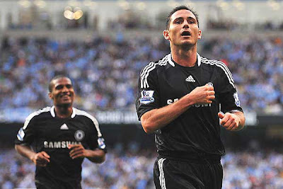 Frank Lampard of Chelsea celebrates scoring his team's second goal of the game against Manchester City. The Blues would add a third to spoil Robinho's debut with a 3-1 victory over Citeh.