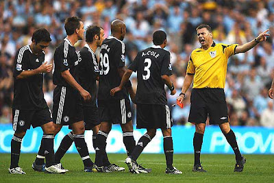 Chelsea players appeal in vain after referee Mike Halsey shows John Terry (#26) of Chelsea a red card.