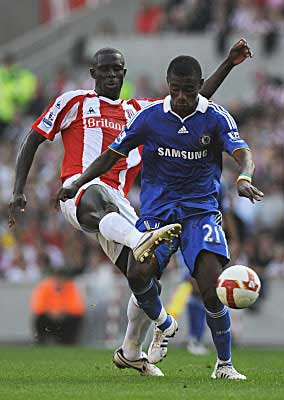 Salomon Kalou of Chelsea is challenged by Seyi Olofinjana of Stoke City during their Barclays Premier League match at the Brittannia Stadium in London, England.