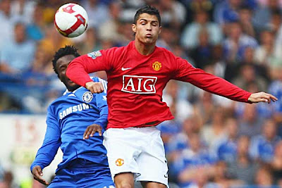 Cristiano Ronaldo of Manchester United jumps with John Obi Mikel of Chelsea. Ronaldo came on for Paul Scholes in the second half.