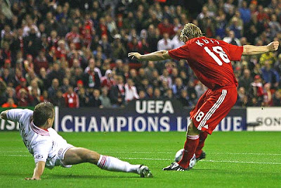 Dirk Kuyt of Liverpool scores the opening goal in the 4th minute during the UEFA Champions League Group D match between Liverpool and PSV Eindhoven at Anfield on October 1, 2008 in Liverpool, England.