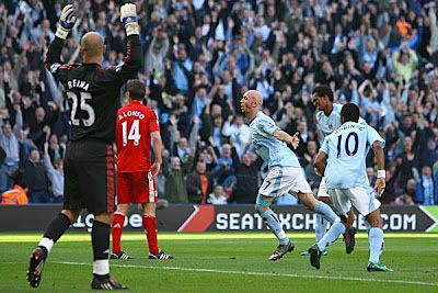 Stephen Ireland of Manchester City celebrates after opening the scoring against Liverpool.