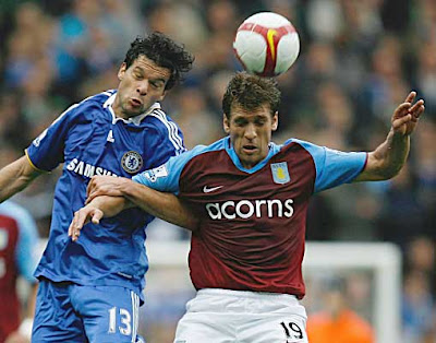 Michael Ballack of Chelsea battles with Stiliyan Petrov of Aston Villa. The Blues won the game 2-0.