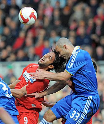 Middlesbrough striker Mido (left) challenges Chelsea defender Alex for the ball.