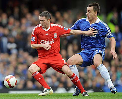 Robbie Keane of Liverpool battles for the ball against Chelsea skipper John Terry during their Premier League match at Stamford Bridge on October 26, 2008 in London, England