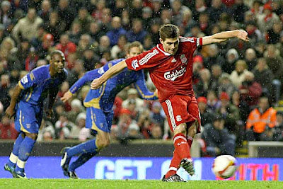Liverpool skipper Steven Gerrard scores against Portsmouth from the penalty spot