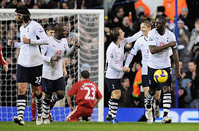 Tottenham players celebrate after the scores are levelled at 1-1 courtesy of an own goal by Jamie Carragher (on floor #23) of Liverpool. Tottenham beat Liverpool 2-1.
