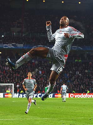 Dutch striker Ryan Babel of Liverpool celebrates after scoring his team's first goal against PSV