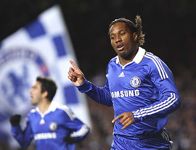 Chelsea striker Didier Drogba celebrates his second half goal against Cluj. The Blues won the match 2-1 to advance to the final 16 in the Champions League knockout stage, but finished second behind Roma.