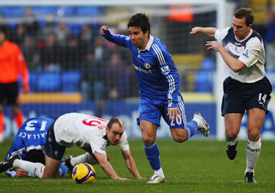 Deco of Chelsea and Kevin Davies of Bolton Wanderers challenge for the ball