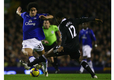Marouane Fellaini of Everton is challenged by John Obi Mikel of Chelsea