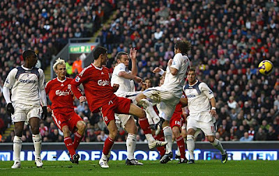 Albert Riera of Liverpool scores the opening goal of the game.
