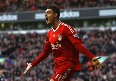 Albert Riera of Liverpool celebrates scoring the opening goal