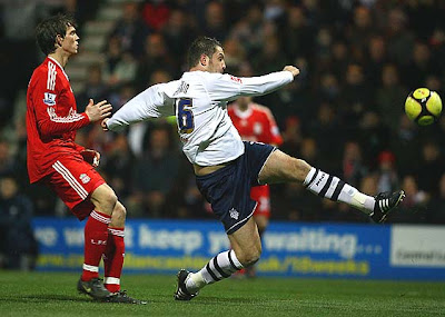 Jon Parkin of Preston North End attacks under pressure from Daniel Agger of Liverpool during their FA Cup third-round match at Deepdale Stadium in Preston, England.